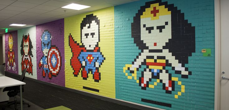 "The word ""office"" usually makes us think of a drab and uninspiring sea of monochromatic cubicles. Not content with the status-quo, designer Ben Brucker decided to spruce his walls up—by creating pixelated superhero murals from over 8,000 post-it notes."