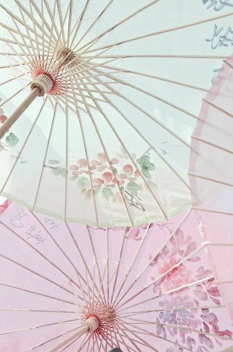 Pastel umbrellas // Pink parasols from Lotus Dreams Poetry & Art Board at Michael McClintock Poet on Pinterest.