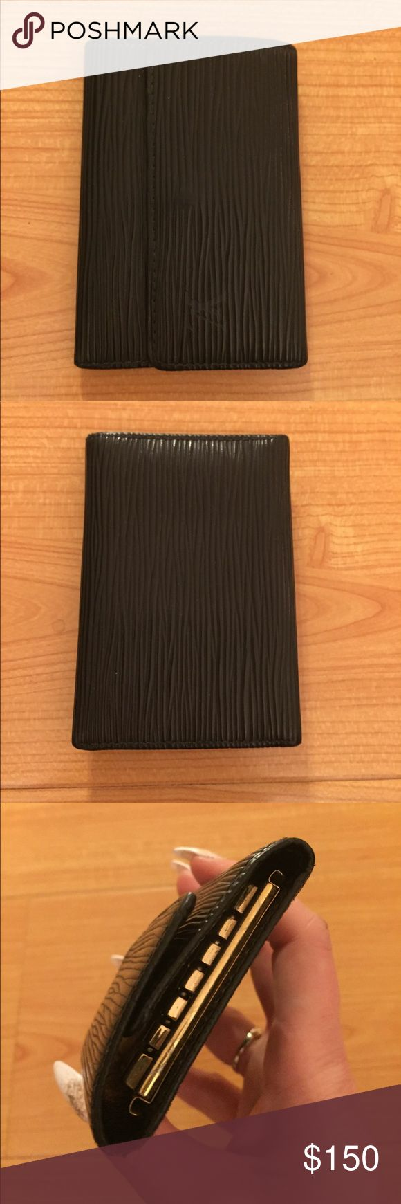 🎄LOUIS VUITTON Black Epi Large Key Wallet Holder Fabulous little key 🔑 holder wallet from Louis Vuitton. Black Epi leather. The larger, 6 ring style. Excellent, like new condition. Snap closure.  Date code CA0020. Absolutely authentic. Louis Vuitton Accessories Key & Card Holders