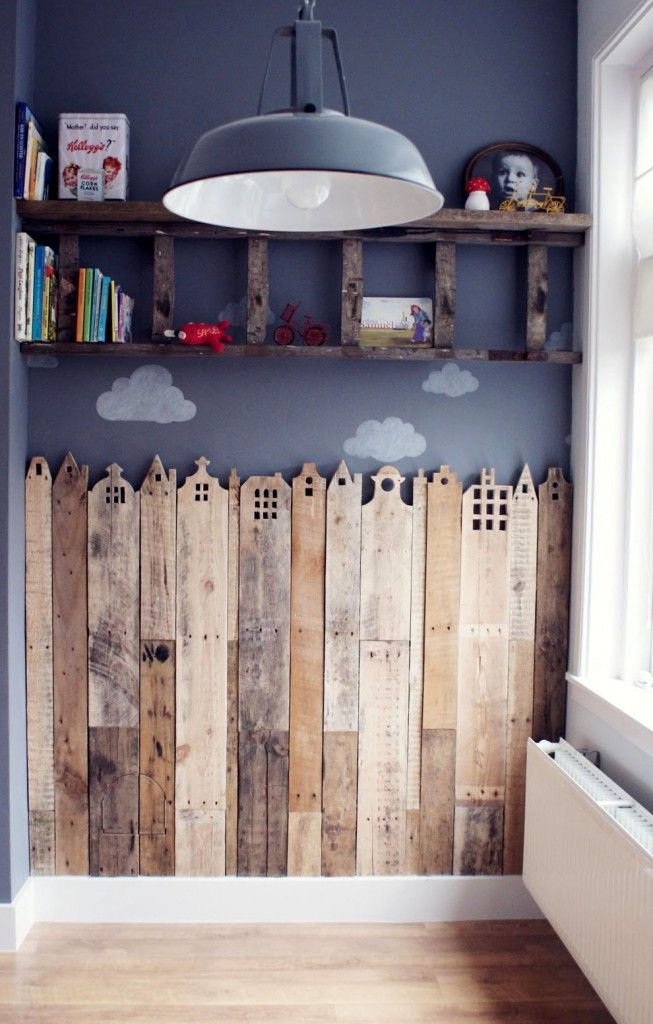 I like the idea of the wood like fence.  You could have one pannel for every child in your classroom and then use it as a growth chart for toddlers.  When the child moves up or leaves the centre you can give it to the parents.  Use Pallet wood.