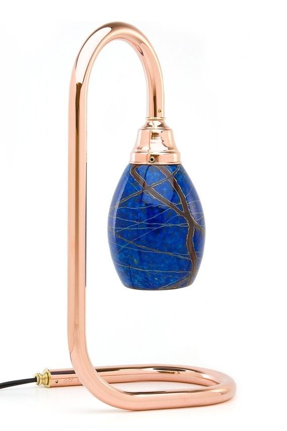 "The Fusion Copper Sculpture Table Lamp with Cobalt blue shade  This stunning copper table lamp with it's glowing presence, on or off, will brighten any area in your home or office with its handcrafted quality and distinction.   The lamp-cord, dimmer and socket are UL listed.   Table lamp dimensions: 18"" High, 7"" Wide, 10"" Deep."