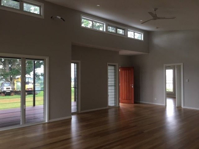 Custom designed single storey home in Maleny with high louvres windows to allow in natural light | Tru-Built Builders Queensland.