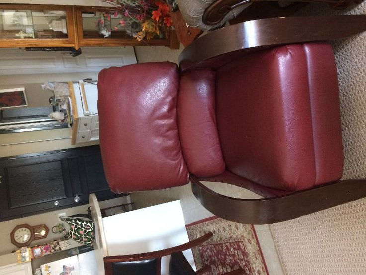 gorgeous, wood and red leather chair. only two years old, great condition!