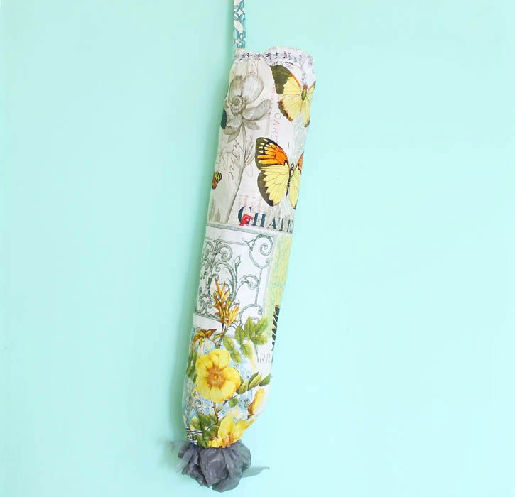 DIY sewing tutorial shows your how to make an Anthropologie inspired plastic bag holder.