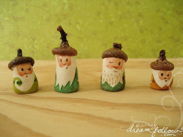 Easy little gnomes made from painted rocks and acorn tops: