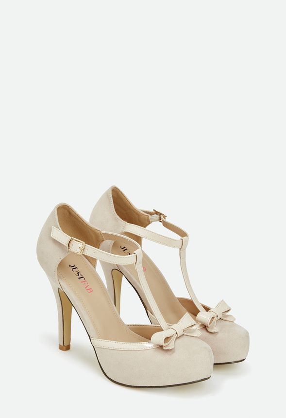 Take on the night with Neda. A feminine pump that's waiting to be taken out on the town, it features a patent t-strap, bow front detail, and a small hidden platform. Faux suede…. – Perla Espinoza