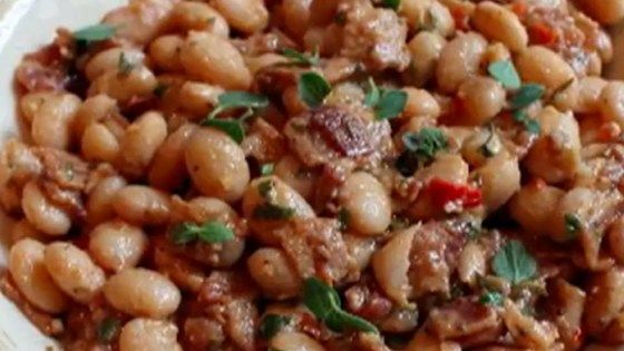 Slow cooked cranberry beans are combined with bacon, lemon, rosemary, and garlic for a smoky and satisfying side dish.