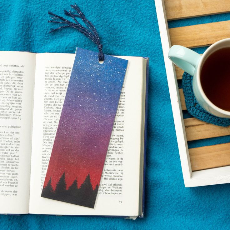 Like to snuggle up under a blanket with a cup of tea and a book? This hand painted bookmark makes reading even more fun :)
