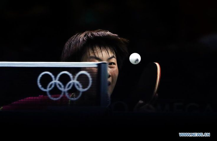 Ding Ning of China serves the ball against Elizabeta Samara of Romania during a 3rd round match of women's singles table tennis at the Rio Olympic Games in Rio de Janeiro, Brazil, on Aug. 7, 2016.  http://infoseekchina.blogspot.com/2016/08/weekly-xinhua-photos-aug-8-aug-14.html