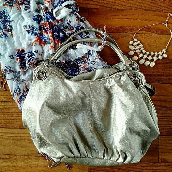 Rosetti metallic bag Super soft and stylish! Good shape, inside does have light pen marks. Rosetti Bags