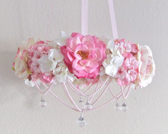 shabby chic mobile.135 on etsy but I can so make this. It's just a ribbon wrapped styrofoam wreath with flowers and beads...