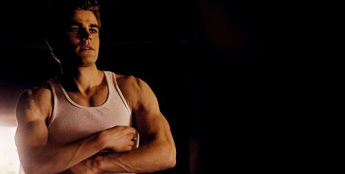 Stefan Salvatore flexing his muscles gif from The Vampire Diaries