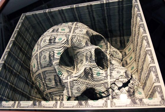How amazing is this skull that's been hand carved from piles of U.S. Money