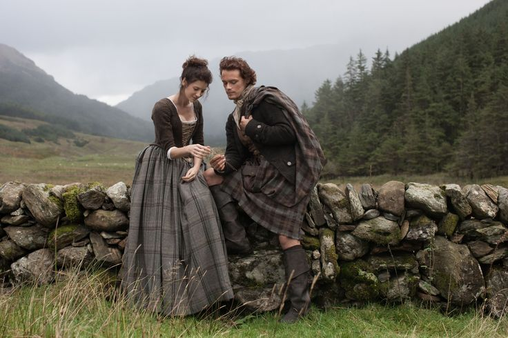 Outlander Promo Still- Caitriona Balfe as Claire Randall and Sam Heughan as Jamie Fraser.