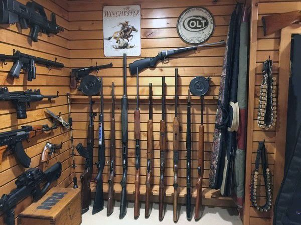 Wood panel walls gun room design ideas awesome gun rooms for Walk in gun safe plans