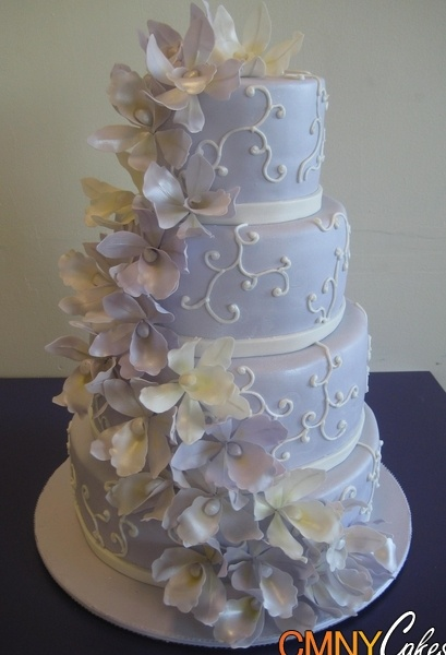 Lavender Orchids Wedding Cake. looking at ORCHIDS to get ideas on how to do them on our wedding cake. LIKE HOW FULL THE CASCADE OF ORCHIDS ARE IN THIS PHOTO. GOOD EXAMPLE FOR WEDDING CAKE SEND TO SPD!