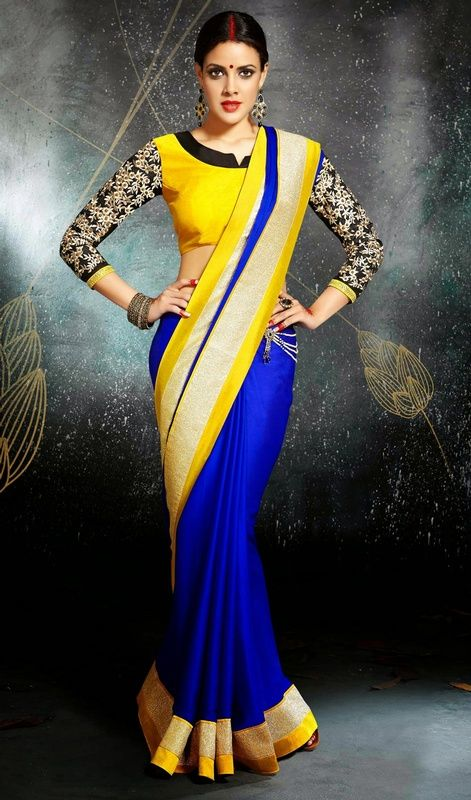Classic blue satin and chiffon sari with contrast blouse makes perfect combo for evening party requirement. Sari is embellished with golden woven lace and contrast yellow border which gives you a royal look. Sari pairs with contrast yellow raw silk stitched blouse as shown in the picture. #OpulentCasualSaree