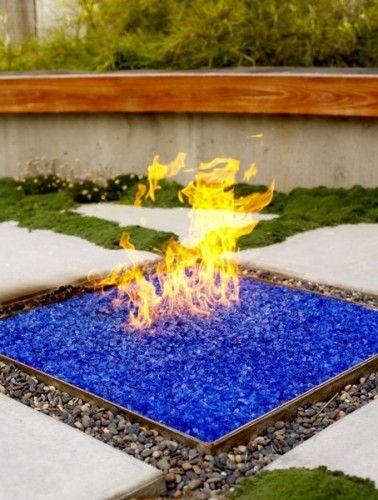 Blue glass/rock fire pit...LOVE IT! #firepit #landscaping