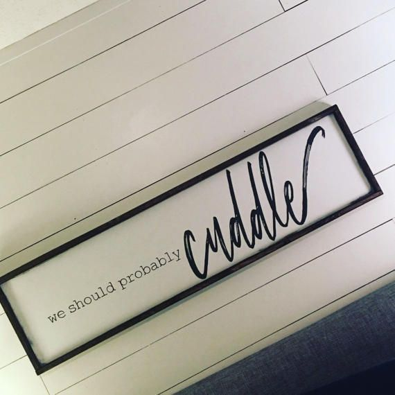 Who doesnt love to cuddle? Right?!? Hang this sign above your bed to encourage great cuddling  *** Free shipping in the continental U.S. *** White Background with Dark Charcoal Lettering and a Dark Stained Frame (message me to change any of these features). *** Finished Dimensions