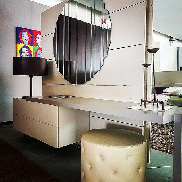 #Essential composition, with #exclusive pieces of #design for #bedroom . Soft seat and linear furniture. Round versus line