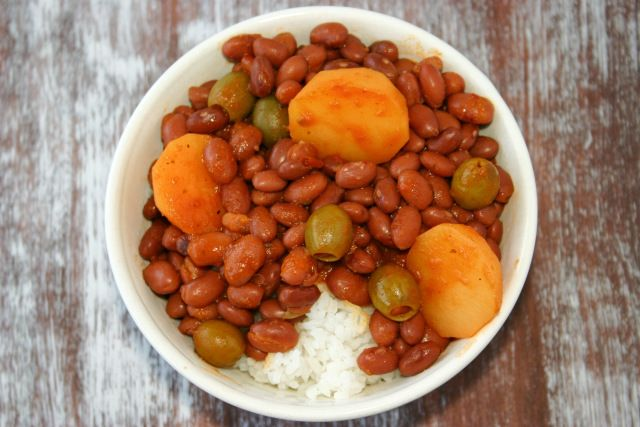 Puerto Rican Rice and Beans. Red beans, potatoes and olives served over rice. My favorite Puerto Rican recipe! kitchengidget.com