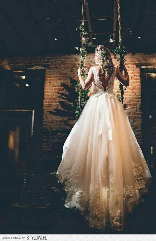 We love the magical look of this gown and the beautiful look of the exposed brick paired with lush greenery.
