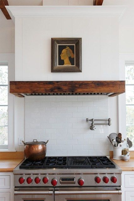 Wooden range hood, and Wolf Stove. Industrial Farmhouse Kitchen.