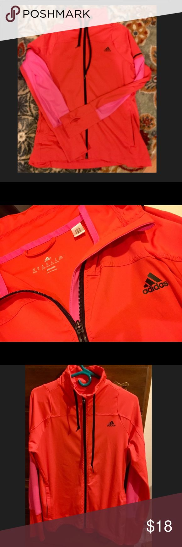 NWOT Woman's Adidas zip up jacket,  size XL NWOT Woman's Adidas zip up jacket,  size XL. So cute! Great orange and hot pink combo and thumb holes! Adidas Tops Sweatshirts & Hoodies