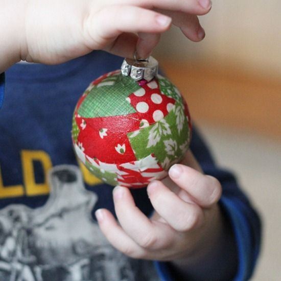 mod podge fabric scraps onto ball ornaments, must try this with the kiddos