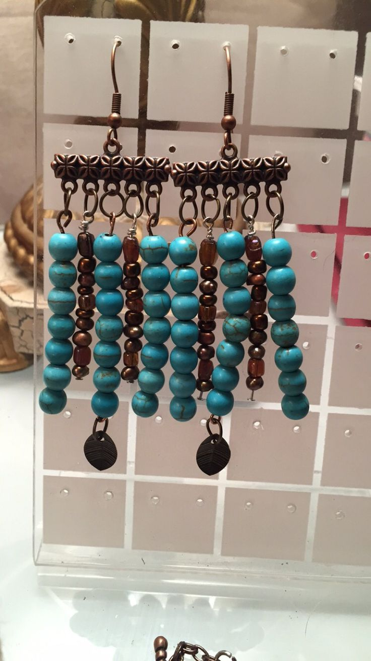 Turquoise and chocolate fresh water pearl five strand earrings
