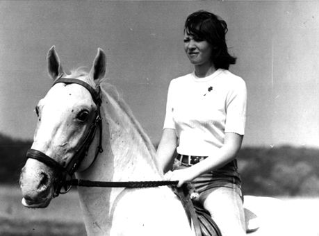 by the way, she also likes horses.. used to ride horses and own one called Maya.