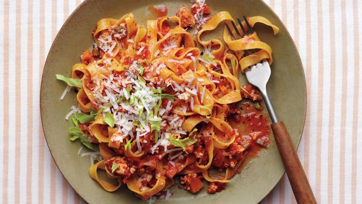 Our light version of pasta Bolognese features ground chicken -- and plenty of flavor