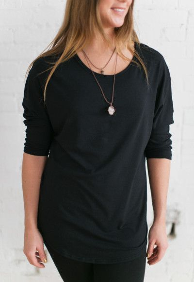 Tiramisu Tunic Top - Black. $66. Made with yummy bamboo/cotton jersey, this scoop-neck top was designed to cover bra straps and has 3/4-length sleeves that can be worn long or pushed up to the elbow. The scalloped hem scoops long in the front and even longer in the back to cover your backside – great for leggings. Available in other colours. Ships in 1-2 weeks. Buttercream Clothing