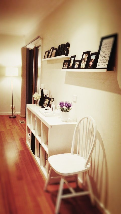 Upstairs hallway decor... I like the black and white and the frames on shelves....