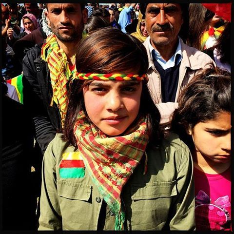 Ahin, a 13-year old Syrian Kurdish refugee from Kobani, at the beginning of the Kurdish New Year celebration, Newroz, in Suruç, Turkey, March 17, 2015. She was wearing a military-style outfit to honor the men and women fighters of the Kurdish YPG militia who defended her hometown from the Islamic State. She said her family is determined to go back home to Kobani to celebrate Newroz on March 21. She is homesick for her friends and for her two brothers who are still in Syria fighting with the…