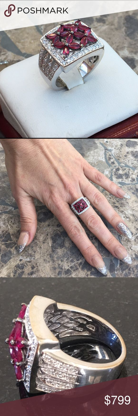 Estate ruby diamond ring 18k white gold 2.5 tcw Stunning estate ruby and diamond halo ring! 18k white gold, 16 marquis rubies 2.08 tcw and 72 round diamonds .43 tcw. Gorgeous condition ! Size 6.5 very comfortable band. Total weight of gold is 11.7 gr. Ring has been appraised at $6855 and appraisal will be included. Happy to provide more photos to serious buyers. No trades please 😍 Jewelry Rings