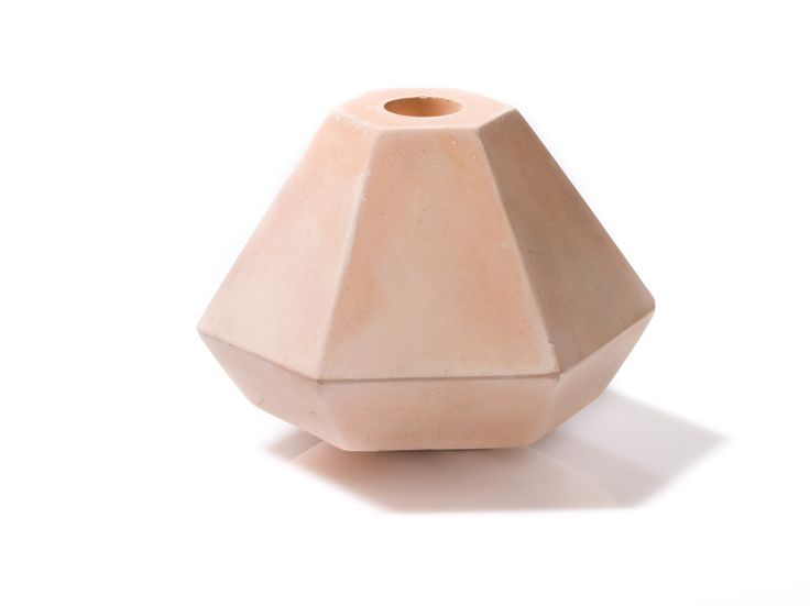 The Diamond Concrete Candleholder is made using a mix of cement and concrete. Before moulding, coloured powder is added to the mixture to give a dusty pastel finish. Owing to the way the mixture dries as it sets, no two candleholders look exactly the same.