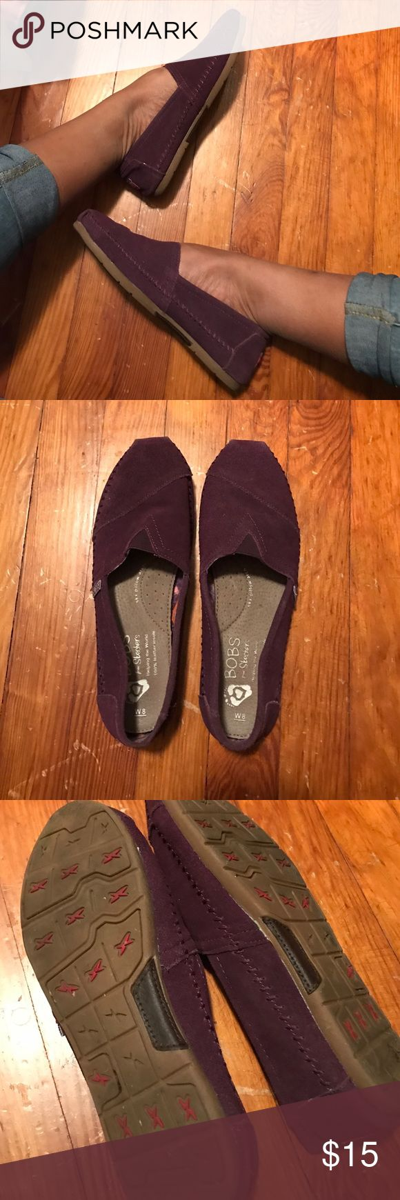 Purple Bobs Shoes Cute Purple bobs shoes. They are very similar to the Toms shoes. Size 8. They are a dark purple suede like material. Very comfortable. Great condition! Bobs Shoes Flats & Loafers