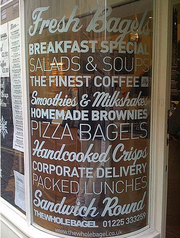 This shop window has a good use of typography which is laid out well and is easy to read. It also uses a different range of type for each line so that it doesn't appear jumbled.