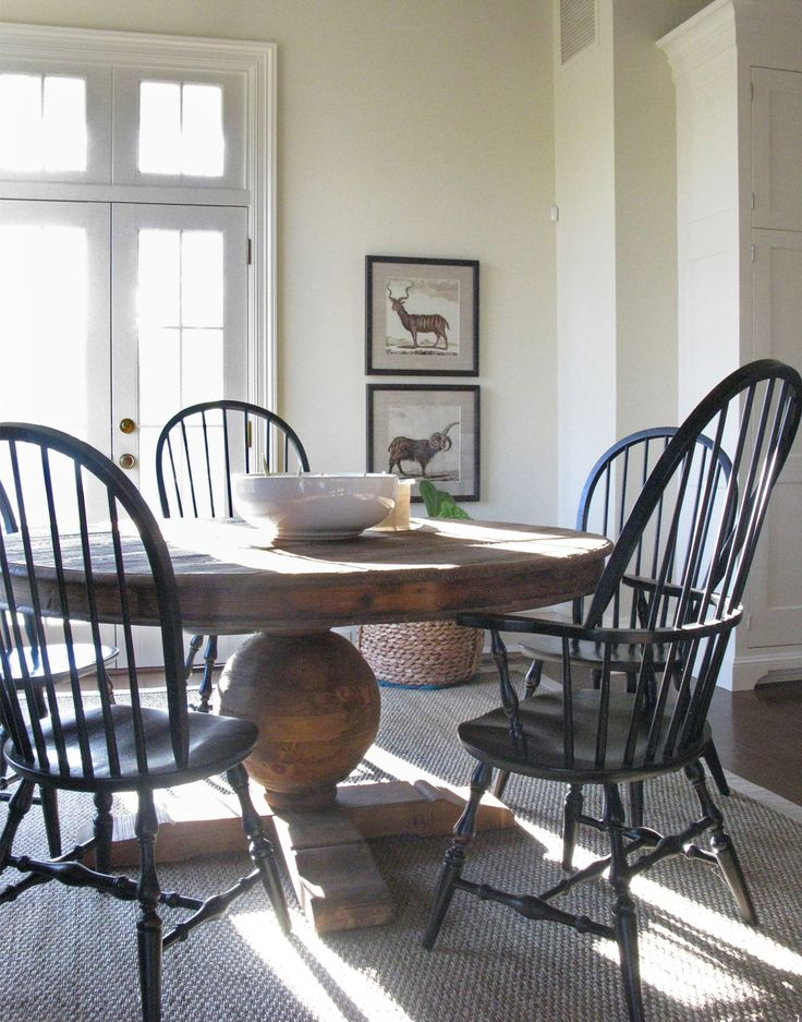 black windsor chairs with distressed pedestal table