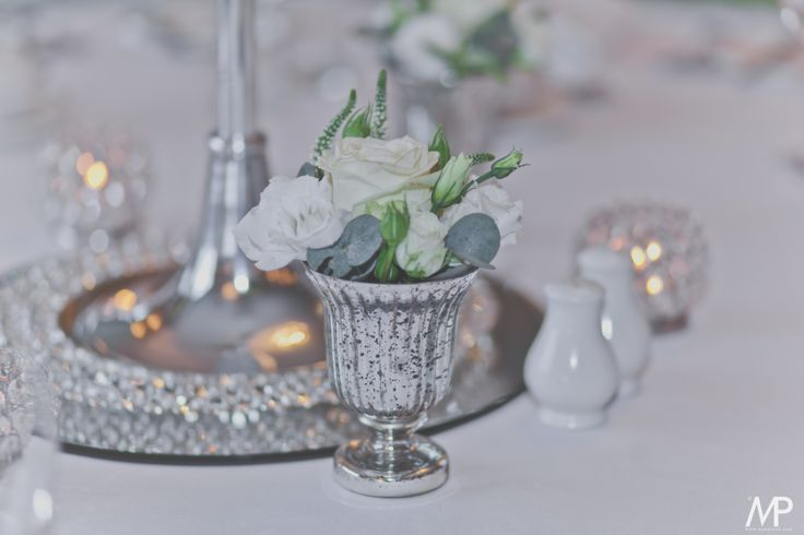 Crystal details with ivory roses