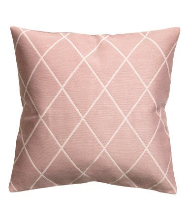 Dusky pink. Cushion cover with a jacquard-weave pattern at front, solid-color back in woven cotton fabric. Concealed zip.
