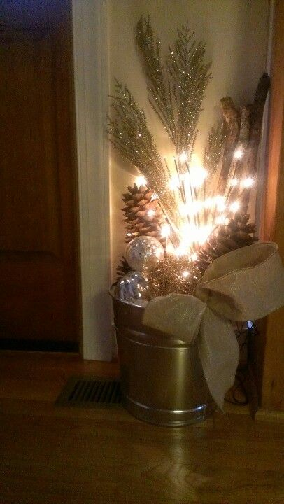 A little bucket of christmas by the front door! Brought to you by my mother and I...our DIY Christmas decor craft for the day!