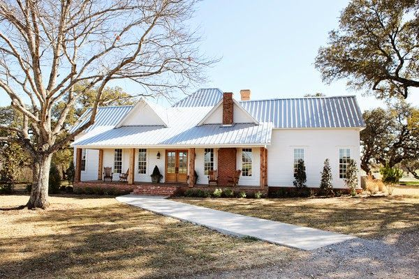 I love this house . . . from the galvanized roof to the covered porch . . . and all the grid windows.  Simple farmhouse style but in the form of a ranch home!  LOVE!!!
