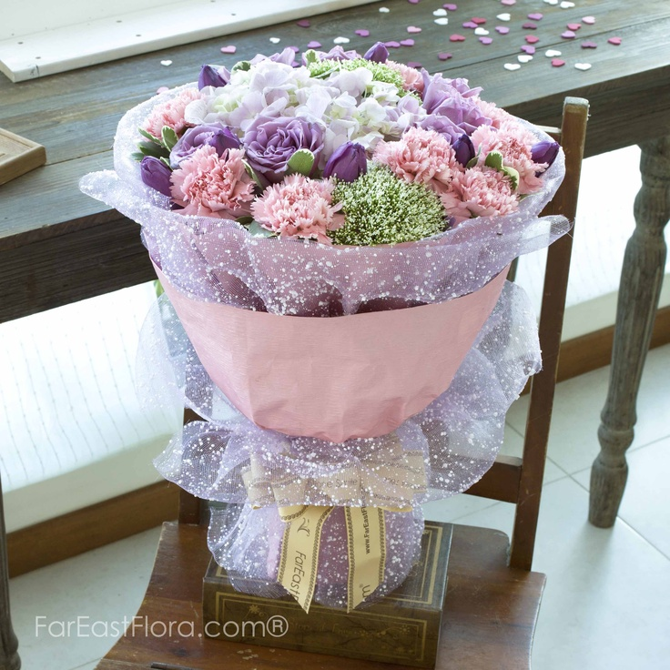 PT30 - Not On A Whimsy  This offering of hydrangea, tulips, roses and carnations in dulcet pastel tones does not need a specific occasion. After all you don't need a special date to express your love. Ultimately, this day is special because you made it so!