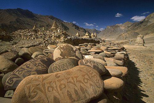 Carved buddhist mani stones below ruined palace, Zangla, India (by Aureika75).