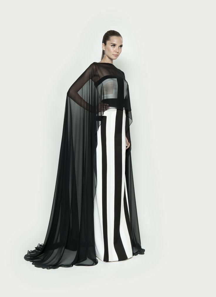 White dress black capes