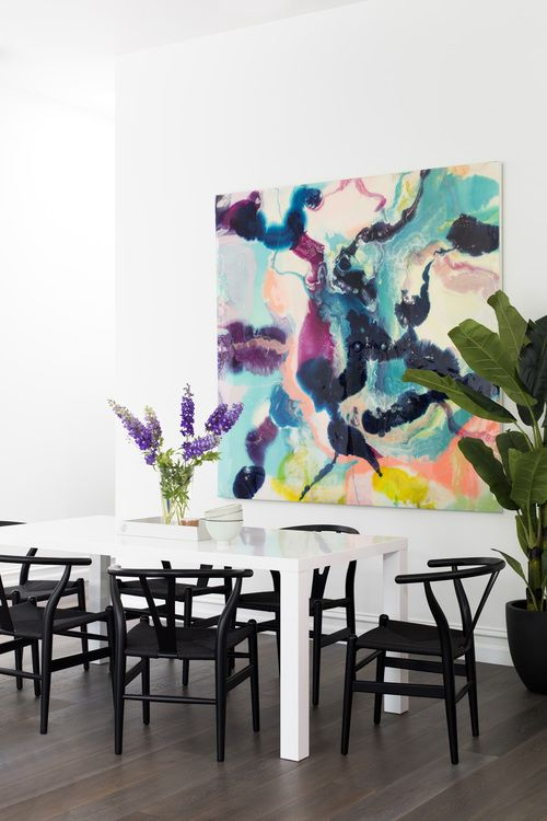 Black Wishbone Chairs With Oversized Art In Dining Room