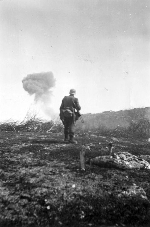 Smoke can be seen from a bunker that was recently attacked by a Junkers Ju 87 dive bomber in Titovka on 29th June, 1941