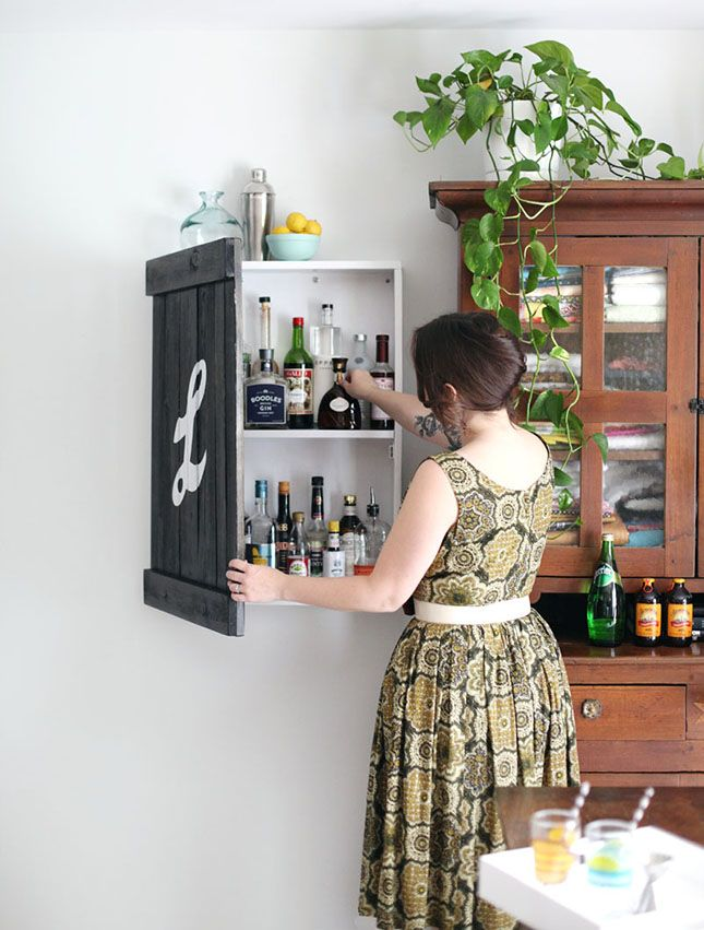 Store your liquor in a DIY cabinet bar.